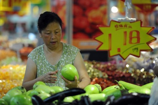 <p>A shopper selects vegetables at a market in Hefei, China's Anhui province. China's industrial output growth weakened in August to its slowest pace in more than three years, official figures showed, confirming a deepening slowdown in the world's second-biggest economy.</p>