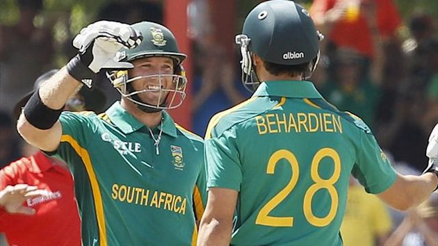 South Africa's Colin Ingram (L) celebrates his century with Farhaan Behardien (Reuters)