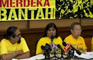 <p>Ambiga Sreenevasan (C), leader of electoral reform pressure group Bersih 2.0 speaks at a press conference in Kuala Lumpur, on April 27. Groups of protesters gathered at various points around the city on Saturday, intent on challenging an official ban on holding their rally at Independence Square in the heart of the congested capital.</p>