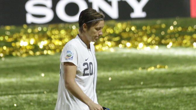 United States' Abby Wambach walks on the pitch after the US lost the final match between Japan and the United States at the Women's Soccer World Cup in Frankfurt, Germany, Sunday, July 17, 2011. The Japanese women's soccer team won their first World Cup Sunday after defeating USA in a penalty shoot-out.(AP Photo/Marcio Jose Sanchez)