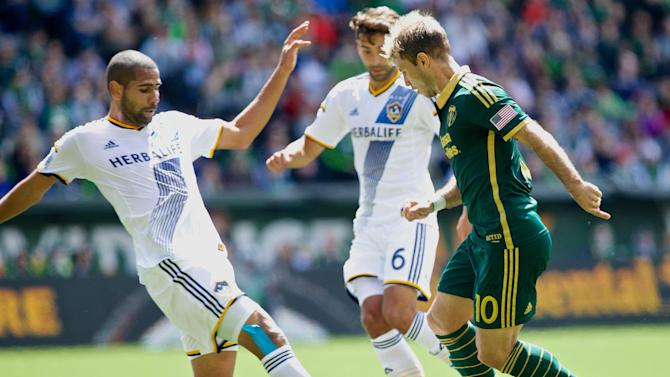 Valeri's late goal helps Timbers draw 1-1 vs. LA