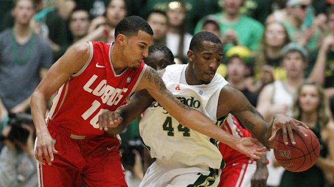 New Mexico guard Kendall Williams, left, tries to steal the ball from Colorado State forward Greg Smith in the first half of an NCAA basketball game in Fort Collins, Colo., on Saturday, Feb. 23, 2013. (AP Photo/David Zalubowski)