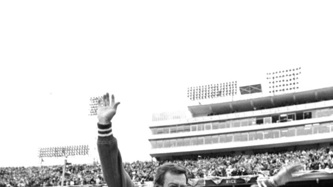 FILE - This Jan. 1, 1973 file photo shows Texas coach Darrell Royal being carried off the field by his players after the Longhorns defeated the University of Alabama, 17-13, in the Cotton bowl in Dallas, Tex. The University of Texas says former football coach Darrell Royal, who won two national championships and a share of a third, has died. He was 88. UT spokesman Nick Voinis on Wednesday, Nov. 7, 2012 confirmed Royal's death in Austin.(AP Photo/File)