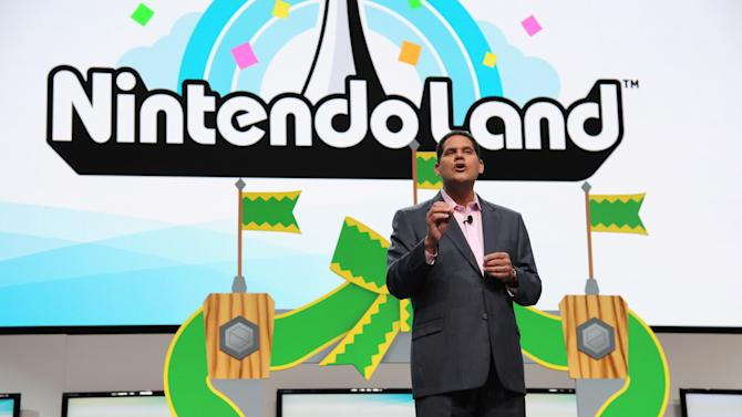 """FILE - This June 5, 2012 publicity photo provided by Nintendo shows Reggie Fils-Aime, Nintendo of America's President and Chief Operating Officer, speaking onstage at the Nintendo All-Access Presentation @ E3, in Los Angeles. The loveable green-skinned critter Yoshi and princess-rescuing adventurer Link and are coming the Nintendo 3DS. The Japanese gaming giant announced plans Wednesday, April 17, 2013, to bring """"Yoshi's Island,"""" """"The Legend of Zelda"""" and """"Mario Party"""" games to its handheld gaming system. (AP Photo/Nintendo, Vince Bucci)"""