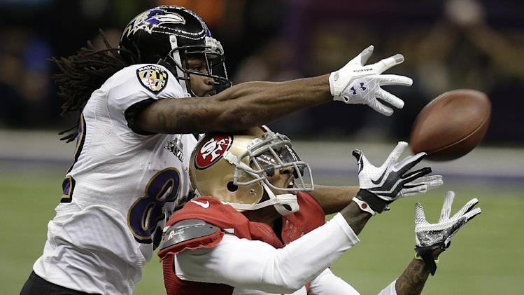 San Francisco 49ers defensive back Chris Culliver (29) breaks up a pass intended for Baltimore Ravens wide receiver Torrey Smith (82) during the first half of the NFL Super Bowl XLVII football game, Sunday, Feb. 3, 2013, in New Orleans. (AP Photo/Gene Puskar)