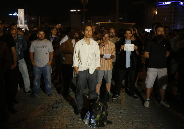 Gunduz stands in a silent protest at Taksim Square in Istanbul