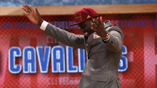 Anthony Bennett from the University of Nevada Las Vegas (UNLV) after being selected by the Cleveland Cavaliers as the first overall pick in the 2013 NBA Draft (Reuters)