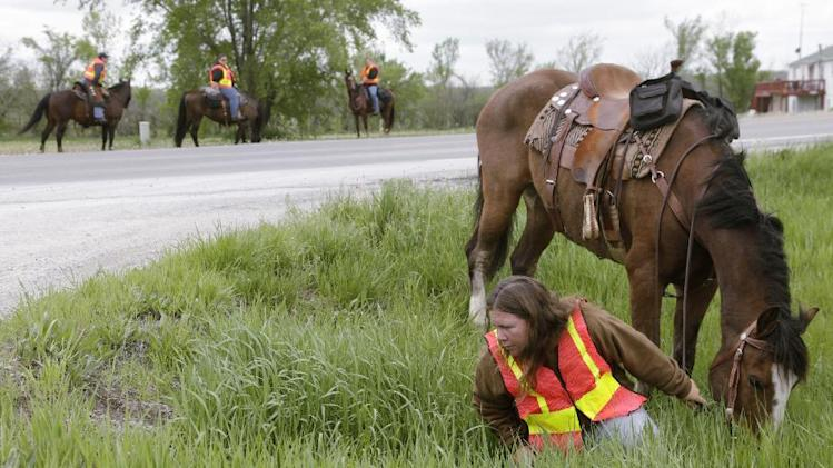 Working with the Franklin County Sheriff's Department, riders on horseback search culverts and drainage ditches along Kansas Highway 68 for 18-month-old Lana-Leigh Bailey, who is presumed dead, Friday, May 10, 2013 west of Ottawa, Kan.  The bodies of her mother and two men were found at an eastern Kansas farm on May 6. (AP Photo/The Lawrence Journal-World, Mike Yoder)