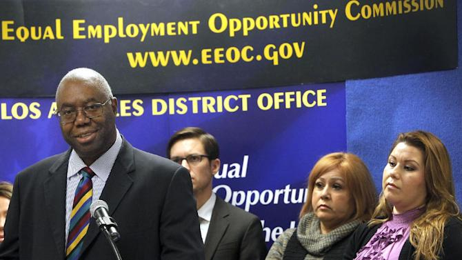 Olophius Perry, District Director, EEOC Los Angeles District Office, talks during a news conference in Los Angeles Tuesday, Dec.18, 2012. Department store chain Dillard's Inc. is paying $2 million to settle charges that it illegally required workers who took sick leave to reveal confidential medical information. The settlement, announced Tuesday by the Equal Employment Opportunity Commission, resolves a four-year-old class action lawsuit that charged Dillard's with violating the Americans with Disabilities Act. (AP Photo/Nick Ut)