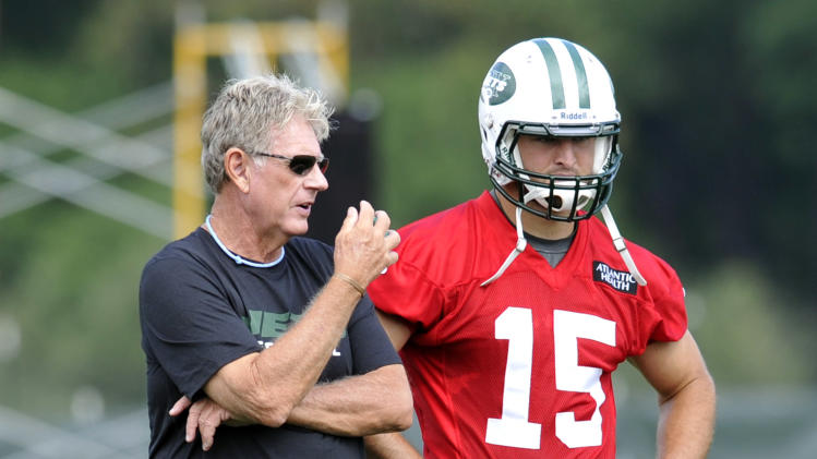 "FILE - In this July 27, 2012, file photo, New York Jets special teams coordinator Mike Westhoff, left, talks with quarterback Tim Tebow on opening day of their NFL football training camp in Cortland, N.Y. Westhoff, the Jets' recently retired special teams coordinator, told a Florida radio station that the way the team handled Tim Tebow was ""an absolute mess."" (AP Photo/Bill Kostroun, File)"