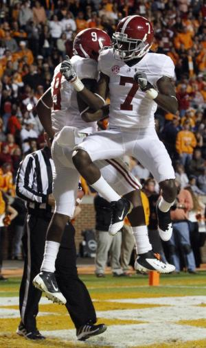 Alabama wide receiver Amari Cooper (9) and teammate Kenny Bell (7) celebrate a touchdown during the first quarter of an NCAA college football game  against Tennessee, Saturday, Oct. 20, 2012, in Knoxville, Tenn. (AP Photo/Wade Payne)