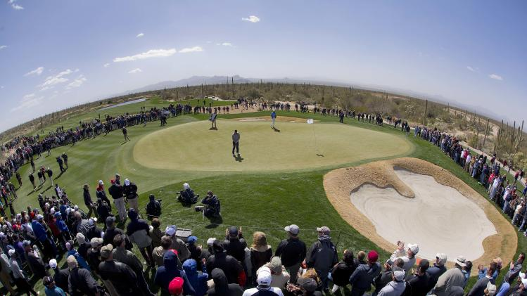Hunter Mahan checks his line to the pin on the fourth green in the final round of play against Matt Kuchar during the Match Play Championship golf tournament, Sunday, Feb. 24, 2013, in Marana, Ariz. (AP Photo/Julie Jacobson)