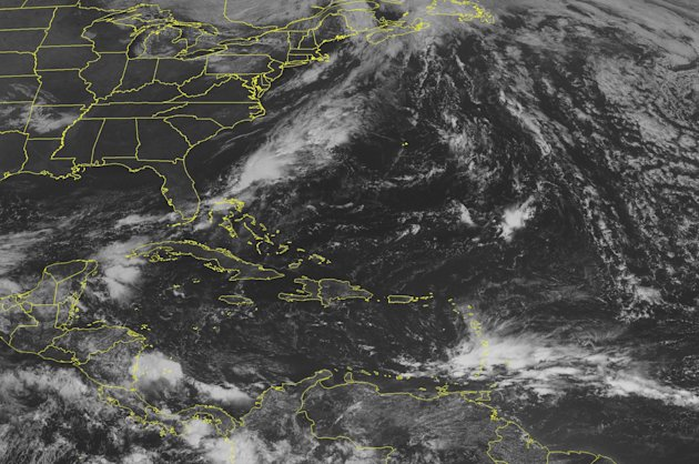 This NOAA satellite image taken Sunday, Sept. 23, 2012 at 10:45 a.m. EDT shows a tropical wave moving toward the Lesser Antilles with an area of showers and thunderstorms. Near the Azores, Tropical Storm Nadine has reorganized and is moving toward the west with maximum sustained winds of 60 mph. In the Caribbean Sea, an area of thunderstorms continues near the Yucatan Peninsula. Quiet conditions across much of the Gulf of Mexico. (AP Photo/Weather Underground)