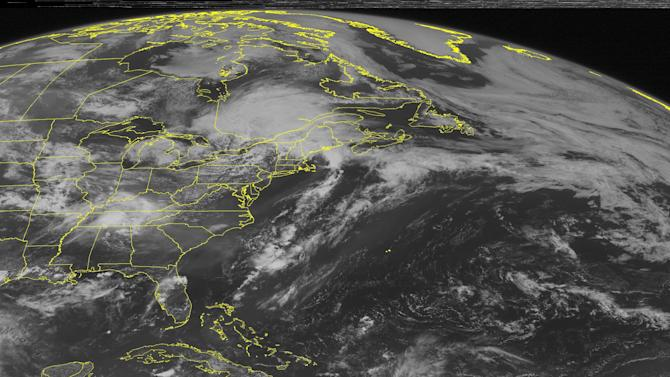 This NOAA satellite image taken Wednesday, July 1, 2015 at 12:45 PM EDT shows a large cluster of thunderstorms firing up over the Tennessee Valley just ahead of a shortwave mid-level trough coupled with lower level moisture. This moisture is flowing northward from the Gulf of Mexico due to a significant ridge that is edging into the Gulf Coast. More thunderstorms are also developing over New England along with a complex low pressure system that is moving in a northeastward fashion. (Weather Underground via AP)