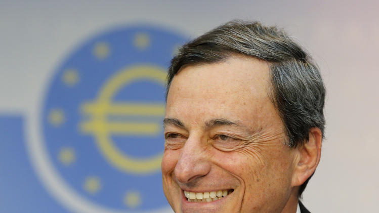 President of European Central Bank Mario Draghi smiles during a news conference in Frankfurt, Germany, Thursday, July 4, 2013, following a meeting of the ECB governing council. The ECB decided to leave the key interest rate unchanged. (AP Photo/Michael Probst)
