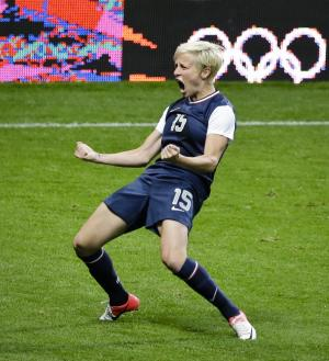 United States' Megan Rapinoe celebrates her goal during a semifinal women's soccer match between the United States and Canada at the 2012 Summer Olympics, Monday, Aug. 6, 2012, at Old Trafford in Manchester, England. (AP Photo/Ben Curtis)