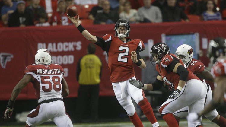 Atlanta Falcons quarterback Matt Ryan (2) works against the Arizona Cardinals during the second half of an NFL football game Sunday, Nov. 18, 2012, in Atlanta. (AP Photo/John Bazemore)