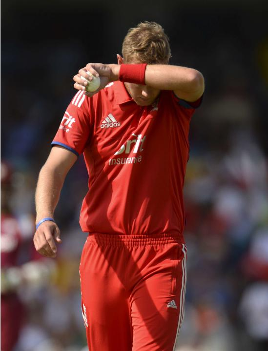 England's Broad wipes his head during the first T20 international cricket match against the West Indies' at Kensington Oval in Bridgetown