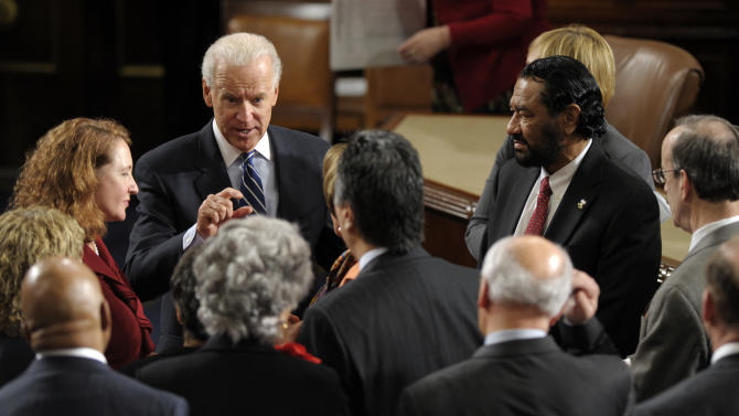 Vice President Joe Biden talks in the House Chamber on Capitol Hill in Washington, Friday, Jan. 4, 2013, following the counting of Electoral College votes. Biden presided over a Joint Session of Congress Friday as four members of the House and Senate took turns announcing the votes that had been tallied in state capitals last month affirming the re-election of Barack Obama as President of the United States. (AP Photo/Susan Walsh)