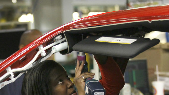 An auto worker assembles parts on the 2013 Dodge Dart at the Chrysler Plant in Belvidere, Ill., Thursday, Feb. 2, 2012. Sergio Marchionne, Chairman and CEO Chrysler Group, announced that Chrysler will add a third shift at the Belvidere Plant to begin production of the Dart. The unemployment rate fell for the fifth straight month after a surge of January hiring, a promising shift in the nation's outlook for job growth. (AP Photo/Charles Rex Arbogast)