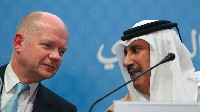 Qatar's Prime Minister and Foreign Minister Sheik Hamad bin Jassim al-Thani, right, chats with with Britain's Foreign Minister William Hague at a press conference following the meeting of the Friends of the Syrian People in Marrakech, Morocco, Wednesday, Dec. 12, 2012. More than 100 countries on Wednesday recognized a new Syrian opposition coalition, opening the way for greater humanitarian assistance to the forces battling Bashar Assad and possibly even military aid. (AP Photo/Abdeljalil Bounhar)