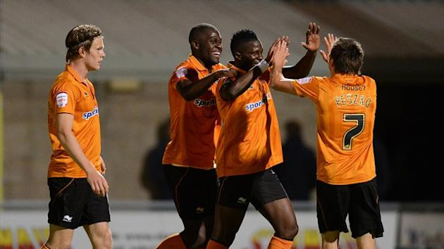 Wolverhampton Wanderers' Bakary Sako (second right) celebrates scoring their third goal (PA Sport)