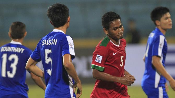 Indonesia's Lestaluhu celebrates his goal against Laos during their Suzuki Cup soccer match in Hanoi