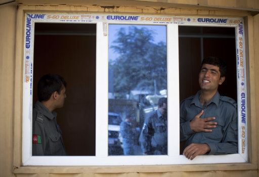 Afghan National Police officers waiting for new recruits at the Police registration office in Kabul, Afghanistan, Saturday, Oct. 13, 2012.
