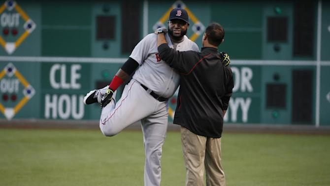 Boston Red Sox's David Ortiz, left, warms up with the help of a team trainer before a baseball game against the Pittsburgh Pirates in Pittsburgh Thursday, Sept. 18, 2014. The Pirates won 3-2. (AP Photo/Gene J. Puskar)