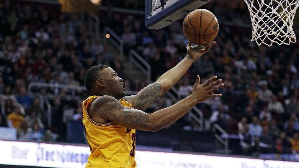 Cleveland Cavaliers' Alonzo Gee, left, shoots against Miami Heat's LeBron James (6) during the second quarter of an NBA basketball game Wednesday, March 20, 2013, in Cleveland. (AP Photo/Tony Dejak)