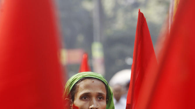 A Bangladeshi garment worker participates in a protest to mourn the death of the victims of a fire in a garment factory in Dhaka, Bangladesh, Friday, Nov. 30, 2012. Hundreds of garment workers protested Friday outside the Bangladeshi factory where 112 people were killed by the fire, demanding compensation for their lost salaries. (AP Photo/Pavel Rahman)