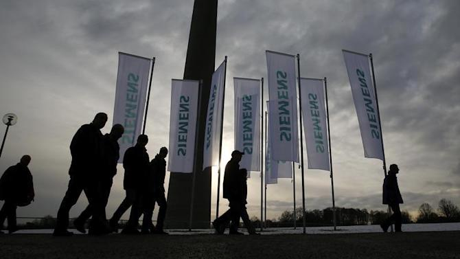 Shareholders of German engineering group Siemens arrive for the company's annual shareholder meeting in Munich