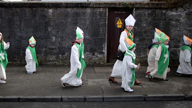 Children dressed as St Patrick make their way to the St Patrick's Day parade in Limerick, Ireland, Sunday, March 17, 2013.  (AP Photo/Peter Morrison)