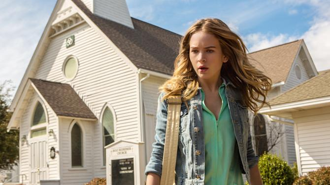 """This undated publicity photo released by CBS Entertainment shows Britt Robertson, as Angie, in a scene from the pilot of the TV series """"Under the Dome."""" CBS is establishing a special unit to develop miniseries and special live programs, an illustration of changing tastes in television. CBS entertainment president Nina Tassler said Wednesday, Jan. 15, 2014, that the new effort is being done in the wake of the miniseries """"Under the Dome"""" last summer. (AP Photo/CBS Entertainment, Michael Tackett)"""