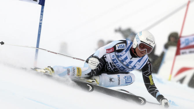 Julia Mancuso, of the United States, speeds down the course during an alpine ski, women's World Cup super-G, in St. Moritz, Switzerland, Saturday, Dec .8, 2012. Mancuso finished in third place. (AP Photo/Marco Trovati)