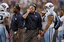 Titans Head Coach Munchak Walks On The Sidelines After Cornerback Sensabaugh Is Called For An Unnecessary Roughness Penalty In Minneapolis