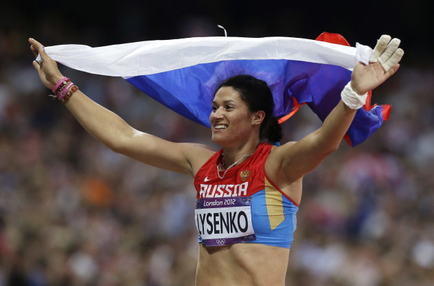 Russia&#39;s Tatyana Lysenko reacts after winning gold in the women&#39;s hammer throw final during the athletics in the Olympic Stadium at the 2012 Summer Olympics, London, Friday, Aug. 10, 2012. (AP Photo/Hassan Ammar)