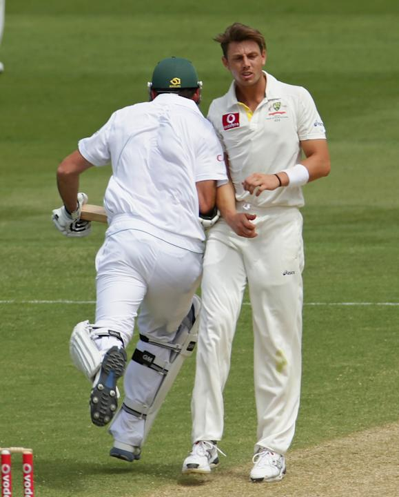 ADELAIDE, AUSTRALIA - NOVEMBER 23:  Graeme Smith of South Africa bumps into James Pattinson of Australia as he runs between the wickets during day two of the Second Test match between Australia and So