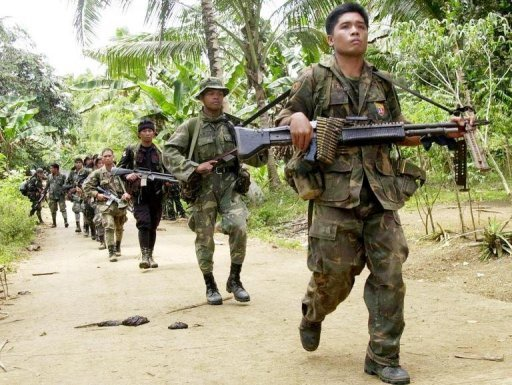 Philippine soldiers search for Abu Sayyaf extremists during a patrol of Basilan island
