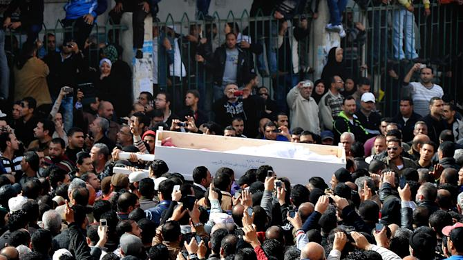 Egyptians carry the coffin of a man killed during a mass funeral in Port Said, Egypt, Sunday, Jan. 27, 2013. Tens of thousands of mourners poured into the streets of the restive Egyptian city of Port Said on Sunday for a funeral for most of the 37 people killed in rioting a day earlier, chanting slogans against Islamist President Mohammed Morsi. (AP Photo)