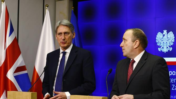 Poland's Foreign Minister Schetyna looks as Britain's Foreign Secretary Hammond speaks during news conference at the Foreign Ministry in Warsaw
