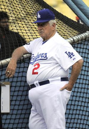Tom Lasorda stands at the batting cage before the Dodgers' baseball game against the San Francisco Giants, Thursday, Sept. 22, 2011, in Los Angeles. His return is nearly 35 years to the day that he took over as manager of the team. Rookie manager Don Mattingly asked Lasorda to serve as an honorary coach for the team's home finale being played on Lasorda's 84th birthday. (AP Photo/Mark J. Terrill)