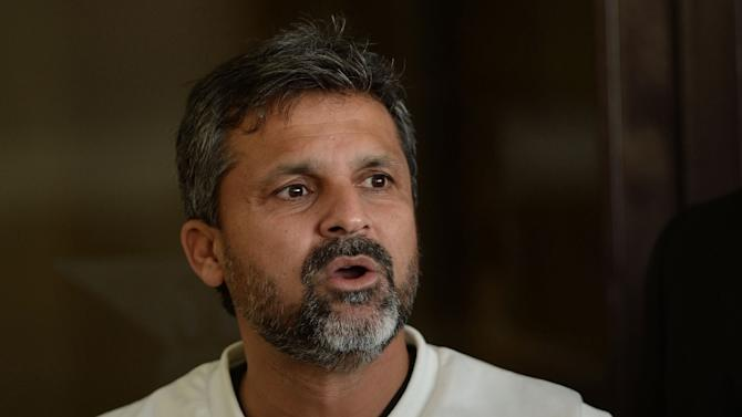 Then Pakistan cricket coach Moin Khan addresses a media briefing in Lahore on February 18, 2014
