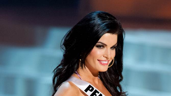 In this photo provided by the Miss Universe Organization, Miss Pennsylvania Sheena Monnin competes during the 2012 Miss USA Presentation Show on Wednesday, May 30, 2012 in Las Vegas. Monnin resigned her crown claiming the contest is rigged, but according to organizers the beauty queen was upset over the decision to allow transgender contestants to enter. A posting on Monnin's Facebook page claims another contestant learned the names of the top 5 finishers on Sunday morning, hours before the show was broadcast.  (AP Photo/Miss Universe Organization, Darren Decker)