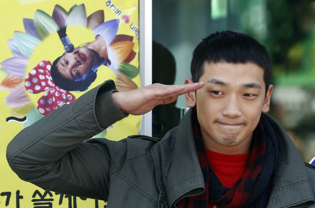 FILE - In this Oct. 11, 2011 file photo, South Korean pop singer Rain gives a military salute to his fans before he enters the army to serve in front of an army training center in Uijeongbu, north of of Seoul, South Korea. Rain is in trouble after paparazzi photos showed him secretly dating a top actress. Seoul's Defense Ministry said Wednesday, Jan. 2, 2012 it is investigating whether Rain broke military rules by meeting actress Kim Tae-hee while on duty. (AP Photo/ Lee Jin-man, File)
