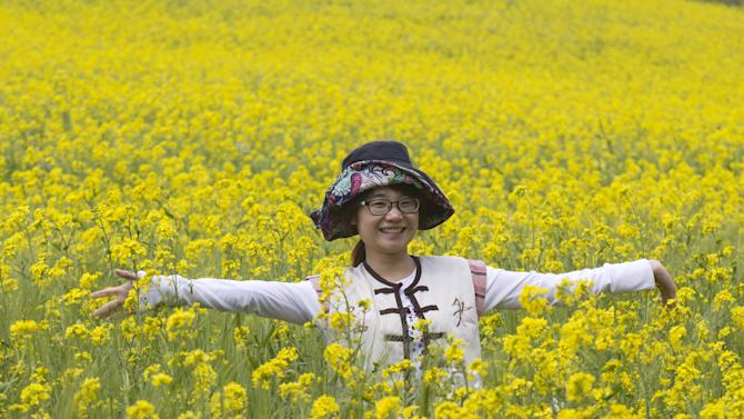 Chinese tourist Luna, 29, poses for a photo at the Antisana National Park in Pintag, Ecuador