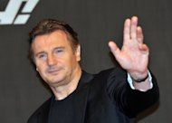 "Actor Liam Neeson poses before a press conference to promote his new film, ""Taken 2,"" in Seoul in September 2012. The film topped the North American box office for a second straight week, besting the Ben Affleck thriller ""Argo,"" industry figures showed Monday"