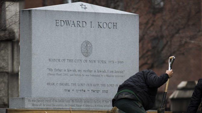 Workers at the Trinity Church Cemetery prepare former New York City Mayor Ed Koch's gravesite, Friday, Feb.  1, 2013, in the Washington Heights neighborhood of New York. Koch, who was New York's mayor for three terms from 1978 to 1989, died early Friday morning from congestive heart failure. He was 88 years old.  (AP Photo/John Minchillo)