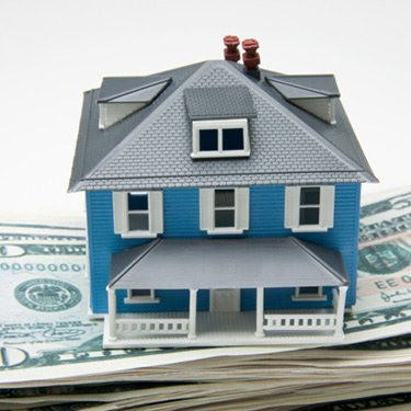 Toy-house-on-stack-of-money_web