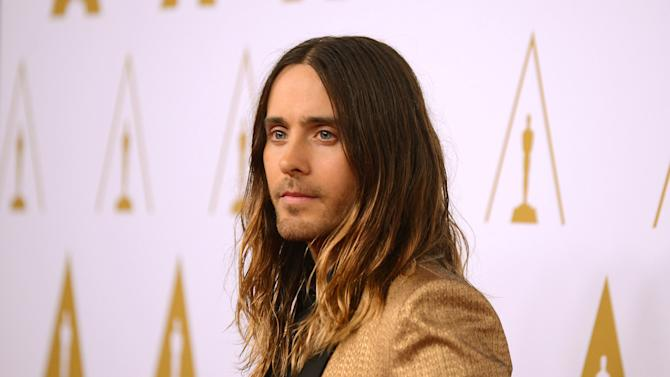 """FILE - In this Monday, Feb. 10, 2014 file photo, actor Jared Leto arrives at the 86th Oscars Nominees Luncheon, in Beverly Hills, Calif. Leto is nominated for an Academy Award for performance by an actor in a supporting role in the film, """"The Dallas Buyer's Club."""" The key to making a red carpet splash is color; and men are getting more colorful like Leto at the nominees luncheon. (Photo by Jordan Strauss/Invision/AP)"""